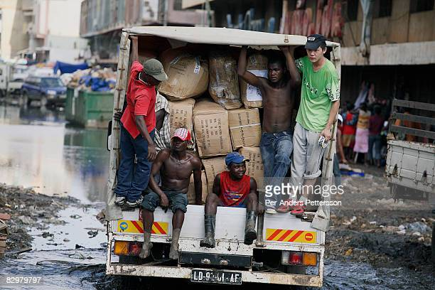 Chinese businessman travels with a truck full of imported Chinese good with his Angolan workers on March 31 2007 at the Chinese market in Luanda...