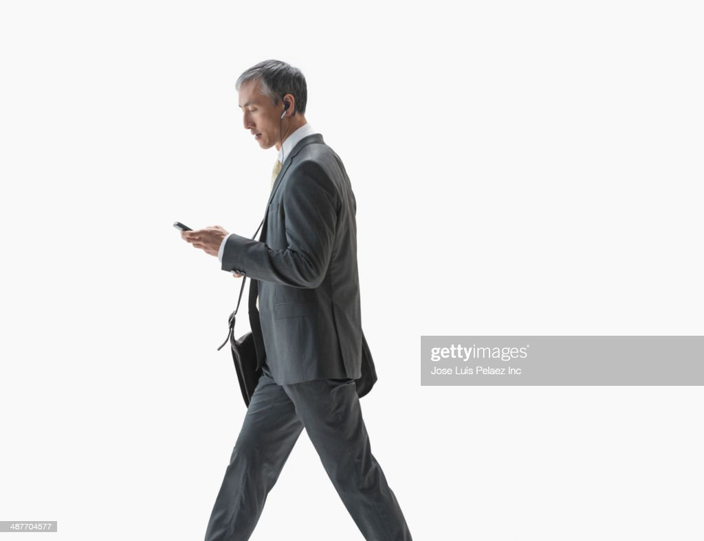 Chinese businessman using cell phone : Stock-Foto