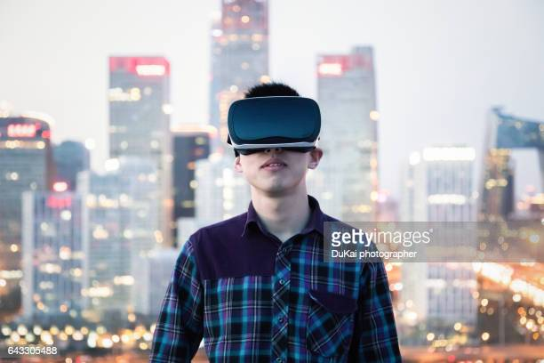 chinese businessman using the virtual reality headset