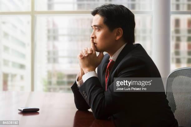 chinese businessman with head in hands - vestuário de trabalho formal imagens e fotografias de stock
