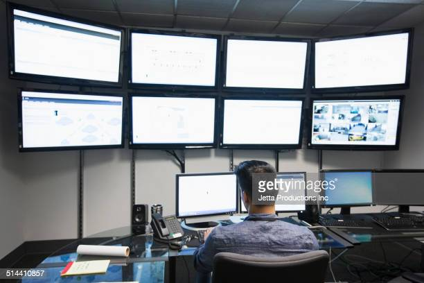 Chinese businessman working in control room
