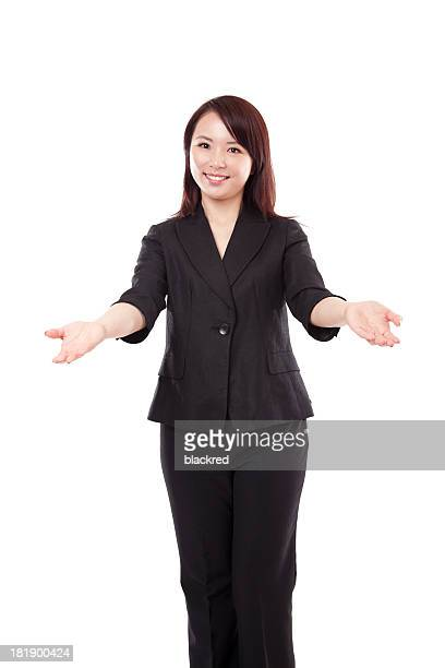 Chinese Businesswoman Arms Outreached Smiling on White Background