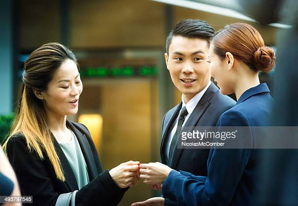Chinese businesswoman handing out her card