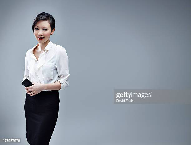 Chinese businesswoman holding mobile phone