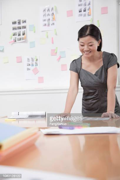 chinese businesswoman working in office - storyboard stock pictures, royalty-free photos & images