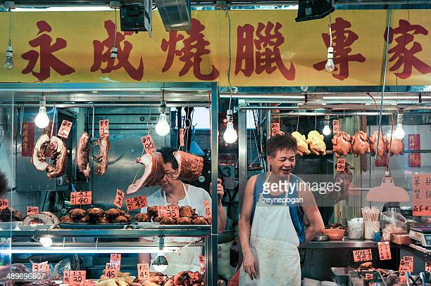 Chinese Butcher at his shop in the market