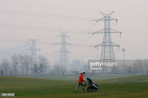 Chinese caddie takes part in a skills competitio on December 2 2005 in Beijing China About one hundred caddies from Beijing attended the event aimed...