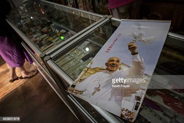 Chinese calendar showing Pope Francis is seen at a local Catholic religious store on August 14 2014 in Beijing China In his first visit to Asia Pope...