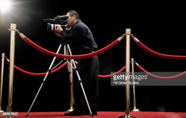 Chinese cameraman with camera on red carpet