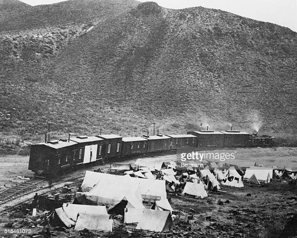 Chinese camp and construction train in Nevada when building of the first transcontinental railroad was being speeded across the state by the Central...