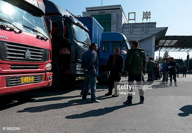 Chinese cargo trucks are waiting at Dandong Port for their clearance time to transport goods to North Korea through Sino-Korea friendship bridge....