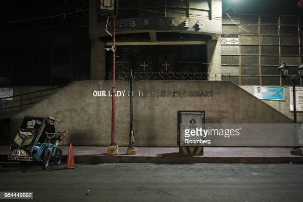 A Chinese Catholic church stands at night in the Chinatown area of Manila the Philippines on Wednesday May 2 2018 Home prices in the metropolitan...