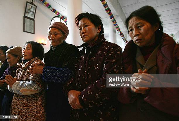Chinese Catholic worshippers wait for a confession session with Father Ren Shaoqian at the statesanctioned Yinjiaba Church before a Christmas Mass on...