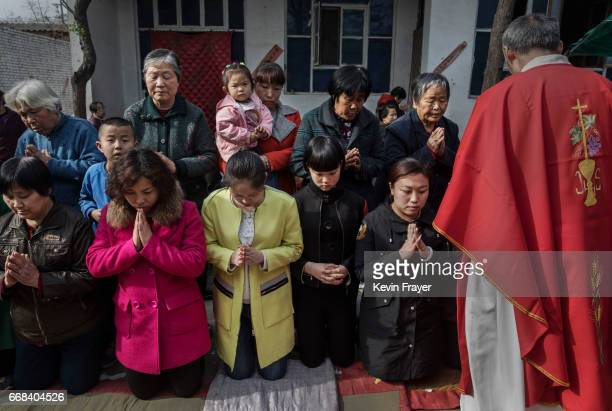 A Chinese Catholic worshippers wait to take communion at the Palm Sunday Mass during the Easter Holy Week at an underground or unofficial church on...