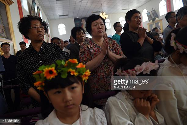 Chinese Catholics attend a mass to mark the ascension of Jesus at a Catholic church in Tianjin in northern China on May 24 2015 AFP PHOTO / GREG BAKER
