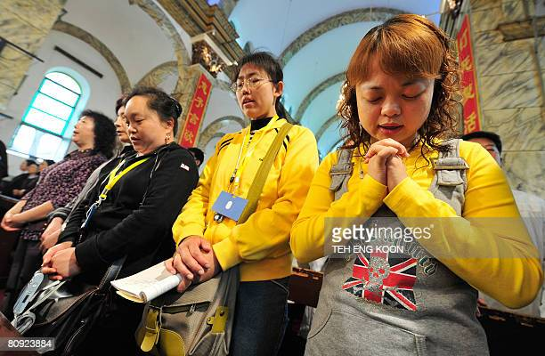 Chinese Catholics attend a special prayer to mark 100 days until the start of the 2008 Beijing Olympic Games at a government approved Catholic church...
