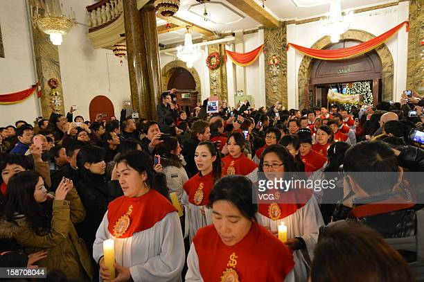 Chinese Catholics pray at the Wangfujing Catholic Church during a Christmas Eve mass on December 24 2012 in Beijing China Though Christmas is not...