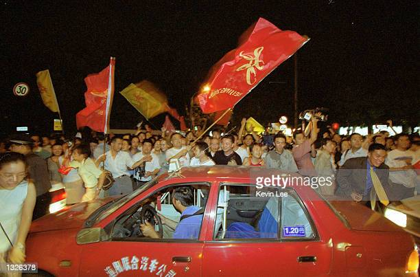 Chinese celebrate after Beijing won the bid for the 2008 Summer Olympics Games July 13 2001 in Beijing Beijing won with 56 votes in the second round...
