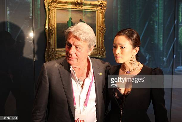 Chinese celebrity Gong Li and French actor Alain Delon visit the France Pavilion at Expo Garden on April 30 2010 in Shanghai China