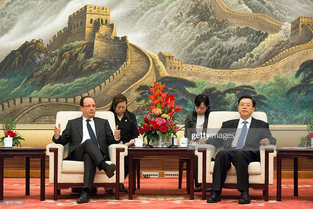 Chinese Chairman of the National People's Congress Zhang Dejiang (R) and France's President Francois Hollande (L) take part in a meeting at the Great Hall of the People in Beijing on April 26, 2013. Hollande arrived in Beijing on April 25 for a two-day China trip aimed at boosting exports to China, with hopes that deals can be reached over the sale of aircraft and nuclear power.