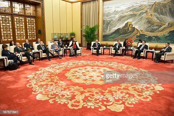 Chinese Chairman of the National People's Congress Zhang Dejiang and Chinese Foreign Minister Wang Yi meet with France's President Francois Hollande...