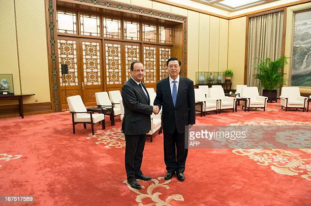 Chinese Chairman of the National People's Congress Zhang Dejiang welcomes France's President Francois Hollande at the Great Hall of the People in...