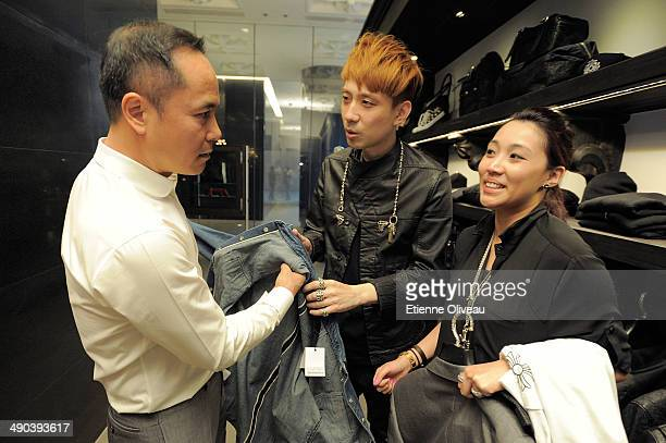Chinese chairman of Yintai Shen Guo Jun puts on a Chorme Hearts designed shirt during the Chrome Hearts Beijing Store Opening on May 14, 2014 in...