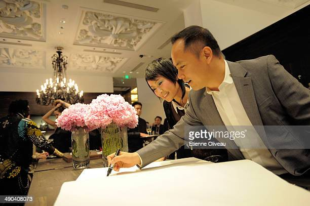 Chinese chairman of Yintai Shen Guo Jun with Hong Kong actress Cecilia Lee signing the guest book during the Chrome Hearts Beijing Store Opening on...