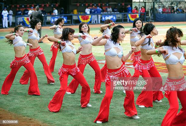 Chinese cheerleaders entertain fans at the second Major League Baseball game in China between the Los Angeles Dodgers and the San Diego Padres on...