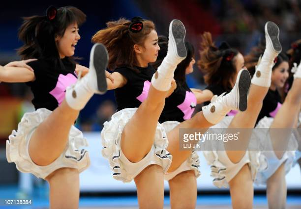 Chinese cheerleaders perform during a break in the men's basketball semifinal between South Korea and Japan at the 16th Asian Games in Guangzhou on...