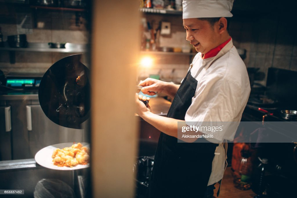 Chinese chef cooking : Foto stock
