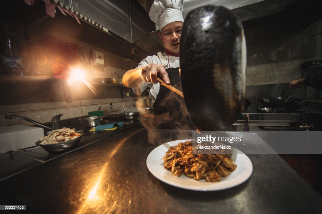 Chinese chef cooking : Stock Photo