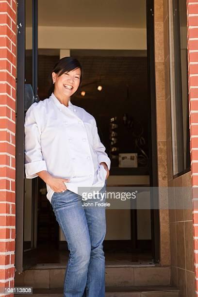 Chinese chef standing in restaurant doorway