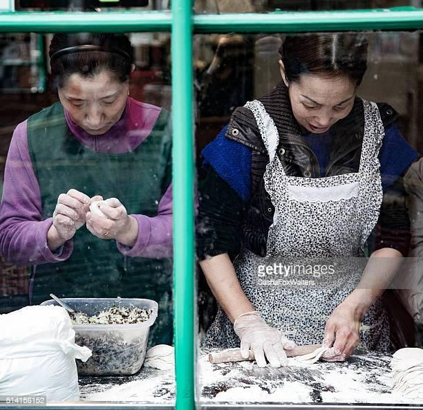 chinese chefs making sushi