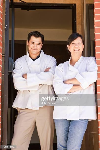 Chinese chefs standing in restaurant doorway