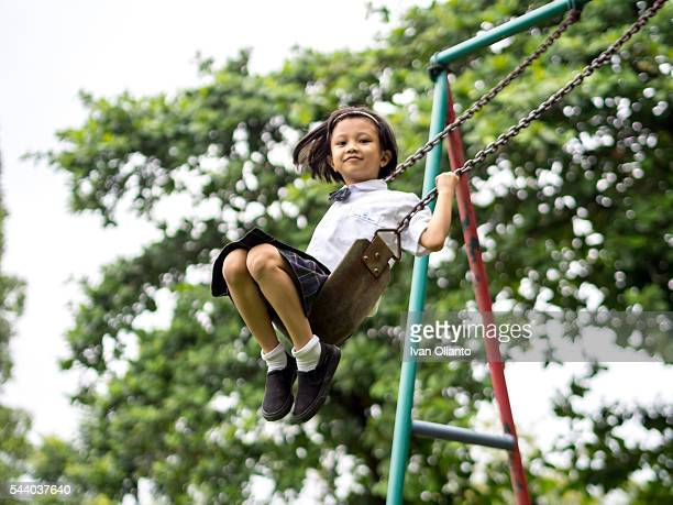 Chinese Child Smiling Play on The Swings