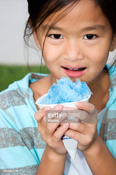 Chinese child with blue snow cone