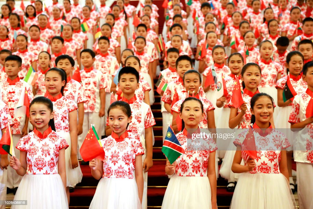 Chinese children hold flags during a rehearsal prior to the opening of the Forum on China-Africa Cooperation (FOCAC) 2018 Beijing Summit on September 3, 2018 in Beijing, China.