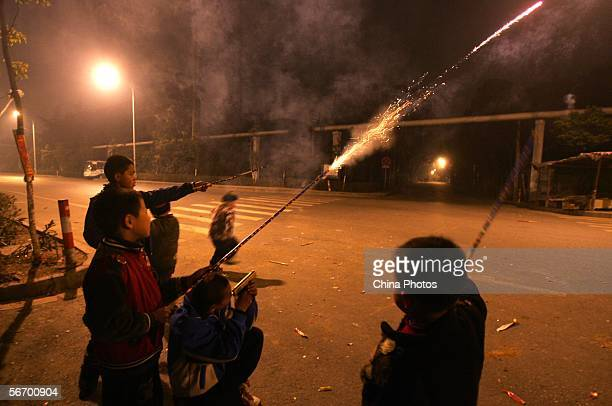 Chinese children light firecrackers at street on the eve of the Chinese New Year of the Dog on January 28 2006 in Wuxi of Jiangsu Province China