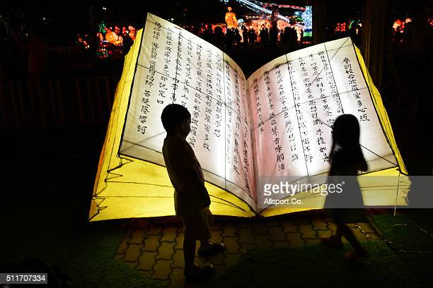 Chinese children look at a giant book lantern at the Fo Guang Shan Dong Zen Temple to celebrate the Lantern Festival on the last day of Chinese Lunar...