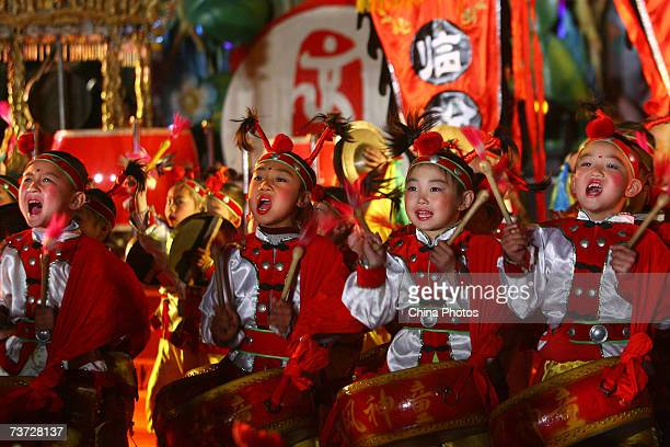 Chinese children play drums during a drum music performance held at the Beijing Happy Valley to mark the 500day countdown for the 2008 Olympic Games...