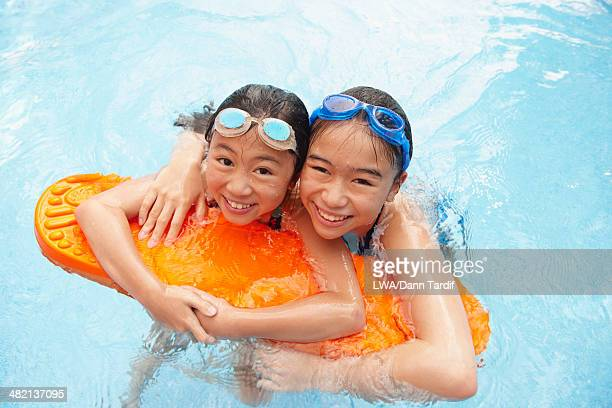 Chinese children playing in swimming pool