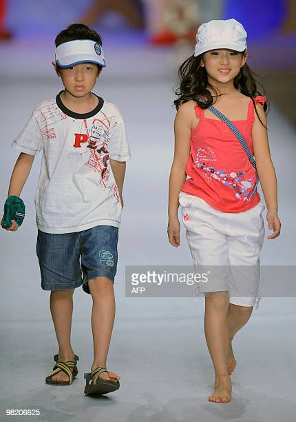 Chinese children present the latest fashion during PEPCO Children�s Wear Collection at the China Fashion Week in Beijing on March 30, 2010. The...