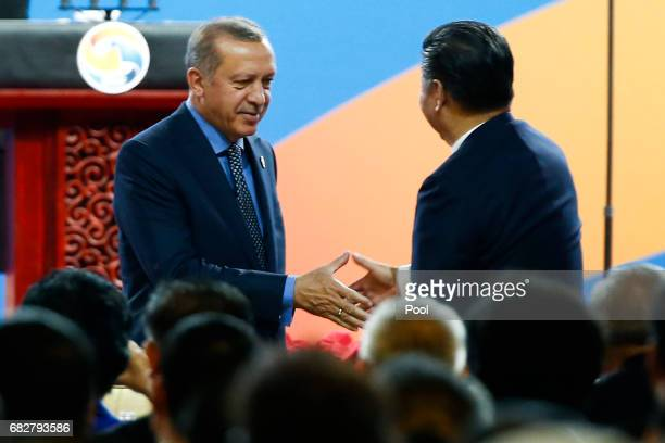 Chinese Chinese President Xi Jinping shakes hands with Turkish President Recep Tayyip Erdogan during the opening ceremony of the Belt and Road Forum...