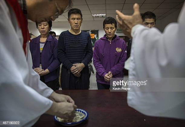 Chinese Christians pray during a communion at an underground independent Protestant Church on October 12 2014 in Beijing China China an officially...