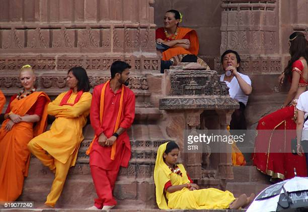 """Chinese cinema actor Jackie Chantakes a break on set with other performers as they shoot a scene of the forthcoming film """"Kung Fu Yoga"""" at Mandor..."""