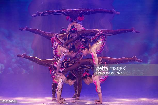 Chinese circus acrobats from the Hebei acrobatic troupe perform in the northern Israeli port city of Haifa on March 29 2016 The group of 30 Chinese...