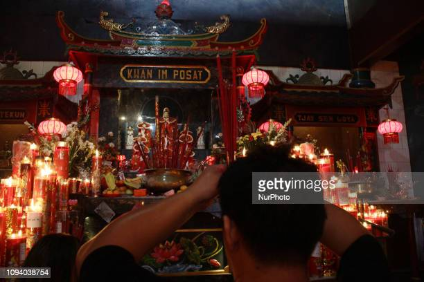Chinese citizens perform worship while celebrating Chinese New Year 2570 at Hok Lay Kiong temple which is the year of Water Pig at Bekasi City West...