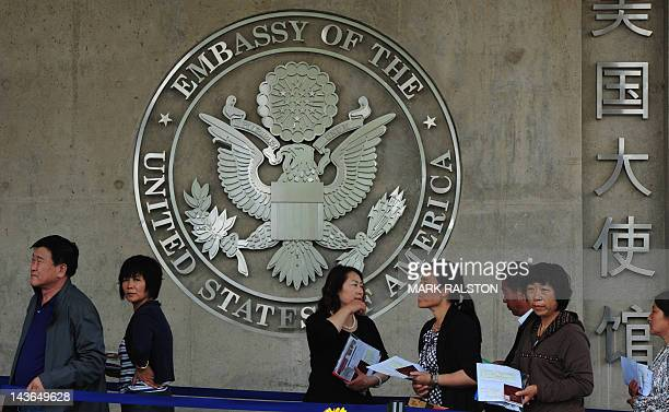 Chinese citizens wait to submit their visa applications at the US Embassy where blind rights activist Chen Guangcheng is believed to be hiding, in...