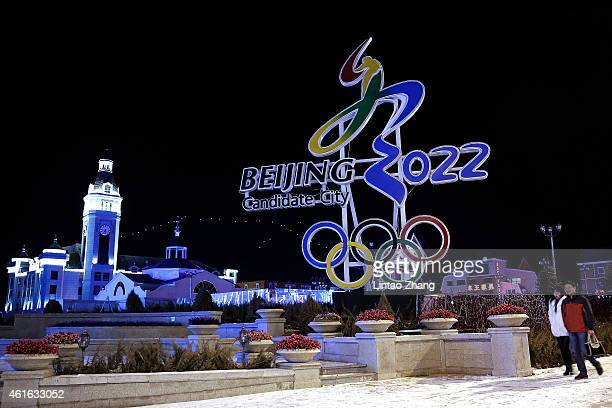 Chinese citizens walks past a a sign for Beijing's bid for the Winter Olympics logo on January 16, 2015 in Zhangjiakou, Hebei Province, China. 2015...